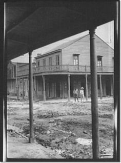Genthe, Arnold, 1869-1942, photographer - Two men crossing an unpaved street, New Orleans or Charleston, South Carolina Print