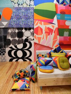 Making their usual colorful appearance at the show was Finnish textile brand Marimekko, who displayed rhombus-shaped swatches of the new season's fabrics across the walls of their booth like a giant psychedelic jigsaw.  Photo by: Ali Morris      Read more: http://www.dwell.com/slideshows/highlights-from-maison--objet-fall-2012.html?slide=1=y=true#ixzz27865mL7J