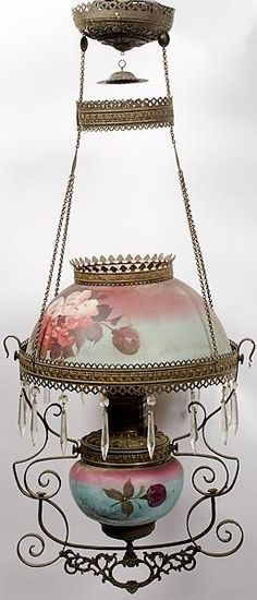 Victorian hanging oil lamp, American, with painted shade and body depicting floral motifs, brass fittings and crystal drop (or prisms) and font with rose decoration.  Ciirca 1860-1900