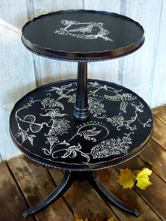 Is this not gorgeous?!  Hand-painted, Two-Tier, Reclaimed Pie Crust Table, Antique White on Black with Bee Emblem. $197.00, via Etsy.