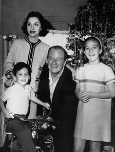 Christmas morning with John Wayne third wife Pilar and their children Aissa and Ethan. 1960s
