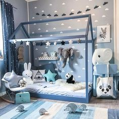 Whimsical blue animal-themed boy's room from a home in Norway.