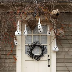 Adorn your front stoop with a tangle of lifeless branches and vines hung from porch rafters. Paint gourds white and add ghostly expressions with black paint. Suspend gourds from the rafters so they hang down among the vines. When darkness comes, the apparitions will be illuminated by shifting shadows, a scene guaranteed to frighten and chill.