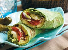 Grilled peppers, zucchini and onion with slaw dressing, pesto and Italian herbs are wrapped with mozzarella and salad greens in this delicious salad wrap.