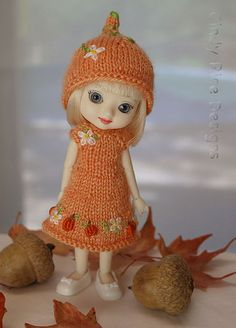 """Tiny Punkin"", a hand knit and embroidered dress/hat set for Amelia Thimble. 