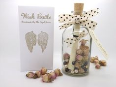 This Wish Bottle allows the happy couple to wish for anything they choose. Simply write your wishes on the scroll inside the bottle and then place