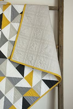 Simple triangle quilt with great modern palette by craftyblossom.
