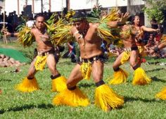 A group of Tahitian male warrior dancers during Heiva I Tahiti.  This dance group is from the Marquesas Islands, French Polynesia.