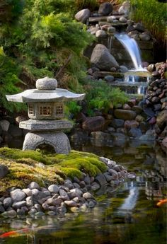 - Water and stones are the basic elements of a Japanese garden. Gold fish thrive in the pond. Photo A-lehtien kuva-arkisto