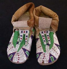 Sioux beaded winter moccasins  courtesy Cameron Trading Post  California, 1880, Pair of Sioux moccasins of Native brain-tanned buckskin with hide soles and strips of soft native-tanned moosehide ankle wraps for added warmth.