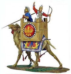 Achaemenid Persian Battle Camel Unit Spearman Riders and Archers were riding in the cabins on these oversize breed of camels. Note the Persian Golden Eagle Emblem on the cabin and Persian Griffins on the camel mat