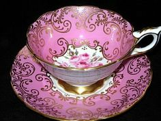 I had one just like this in my antique tea cup when I was a child. I don't think I would collect them now, too much dusting!!