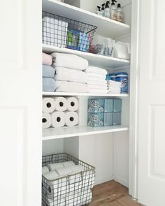 Organized linen closet using baskets and boxes
