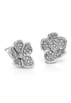 These Monique Lhuillier floral stud diamond earrings in 18k white gold will brilliantly enhance your spring look.