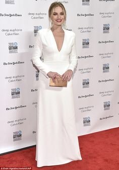 Flawless: Margot, 26, also chose a deep low-cut look; the Australian actress chose a floor-length white dress with a plunging neckline and long sleeves