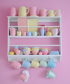 This would be cute to make for Vivi's play dishes and put above her little sink.  :)
