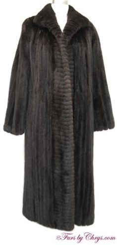 Blackglama Ranch Mink Coat #RM698; $800 (reduced!); Very Good Condition; Size range: 6 - 10. This is a gorgeous vintage genuine natural ranch mink fur coat. It has a Hopper Furs and Blackglama labels and features a shawl collar. The body is constructed of corded mink with horizontal corded mink at the closure edges.  It has an open design (no closures), although they could be added easily and inexpensively by a seamstress or furrier if you so desire. It is perfect for puttin' on the Ritz!