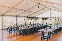 10m marquee structure, marquee wedding, outdoor wedding, white roof, clear walls, festoon lighting, vintage tables, bentwood chairs, south coast weddings, south coast party hire