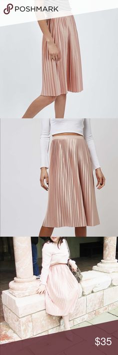 Topshop Blush Pleated Jersey Midi Skirt Lovely midi skirt in blush pink color. Satin like look. Pleats make this so pretty and feminine! Stretchy elastic waistband. Full skirt. Size 8 US but runs a bit big. Excellent condition, worn twice. Topshop Skirts Midi