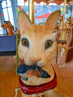 Cat with fish figure on the Dentzel Carousel at Please Touch Museum in Philadelphia.