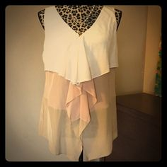 Ann Taylor Silk Tiered Waterfall Blouse --- Sz 10 Ann Taylor Silk Tiered Waterfall Blouse --- Sz 10 --- 100% silk --- Cream, Dusty Rose, and taupe panels --- good used condition, no imperfections --- bust is 20 inches ---  length is 25 inches ---    Thank You for visiting my closet, please feel free to ask any questions Ann Taylor Tops Blouses