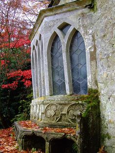 <3 Gothic windows with antique stone/metal bench in autumn <3
