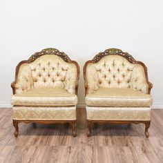 "This pair of ""Chateau Chambord"" armchairs are upholstered in a durable silk fabric with a light beige peach floral print. These French rococo chairs are in great condition with a curved tufted back, glossy solid wood trim and gold carved floral details. Elegant and classic armchairs perfect for a sitting room! #victorian #chairs #armchair #sandiegovintage #vintagefurniture"