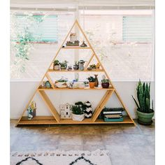tbt to last week's gorgeous home tour and this handmade triangle bookcase!