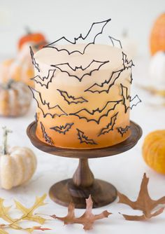 Bat Cake - Bat Cake photo of an ombre orange cake covered in candy melt bats on a wooden cake stand Halloween Desserts, Plat Halloween, Fete Halloween, Holidays Halloween, Halloween Treats, Halloween Cake Decorations, Halloween Cupcakes, Halloween Stuff, Halloween Smash Cake