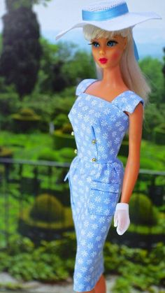 Mod Barbie wearing vintage fashions.