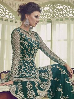 Dark Green Embellished Indian Gharara Palazzo Suit features very intrinsic designer embroidery with zari stone and pearl detail over its net top paired with matching ghera embroidered net palazzo b. Pakistani Designer Suits, Designer Anarkali, Indian Designer Outfits, Designer Dresses, Designer Wear, Palazzo Dress, Palazzo Suit, Desi Wedding Dresses, Wedding Suits