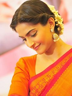 Middle parted twisted bun with mallige huvu in hair # indian Hairstyles 18 Indian Wedding Hairstyles with Jasmine Flowers Indian Bun Hairstyles, Saree Hairstyles, My Hairstyle, Trendy Hairstyles, Sonam Kapoor Hairstyles, Bollywood Hairstyles, Office Hairstyles, Anime Hairstyles, Hairstyles Videos