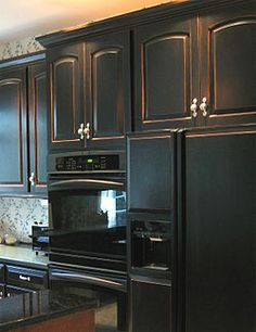 never saw black cabinets before.looks cool. Black cabinets with a distressed hint of warm oak/cherry underneath; all with concrete stained floors & a rich granite countertop & cream walls. Black Kitchen Cabinets, Oak Kitchen Cabinets, Distressed Kitchen, Trendy Kitchen, Distressed Kitchen Cabinets, Home Kitchens, New Kitchen Cabinets, Kitchen Renovation, Primitive Kitchen
