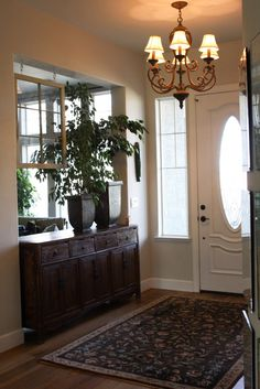 Olive and Love » Old Window Pane with Hand Made Glass Beads-Love how she used the large piece of furniture to block the doorway & make the foyer look wider.....
