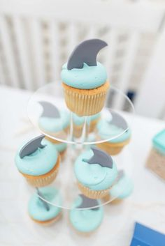 Shark cupcakes at a beach birthday party! See more party planning ideas at CatchMyParty.com!