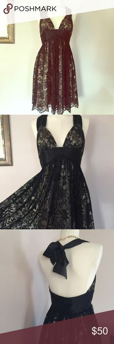 "Nude & Black Lace Formal Cocktail Dress Prom Gorgeous lace halter dress with nude lining and lush black lace overlay. Top of dress is a halter style that ties In a large bow around the neck (seen in the back of dress). Cups of dress are lightly padded, and the waist is trimmed with a wide black band. The hem of the dress is done in scalloped lace. Too cute for words, and would make a lovely dress for a guest of a wedding or formal event. Tagged a size 4, and measures: 32"" across the chest…"