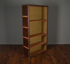 Discontinuted Item Limited Stock Available 1 in Dallas 1 in Palm Beach    Large Keats Wide Tall Cigar Leather Bookcase with Adjustable Shelves Sold in As Is Condition,Final Sale Item ORIGINAL PRICE: $2,975.00  NO ADDITIONAL DISCOUNTS APPLY