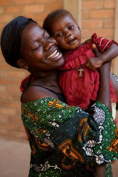 PHOTO OF THE WEEK: 14 June 2012 - A woman living with HIV embraces her daughter in the maternal and child health unit at Moundou Hostpial in Moundou, Chad.    The woman participated in a UNICEF-supported programme to prevent mother-to-child transmission of HIV (PMTCT).     The result? Her daughter is HIV-negative. Amazing.
