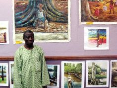 Liberian artist Fato Wheremongar stood in front of a collection of his paintings last week at The Artist Tree gallery in Breckenridge and asked the crowd if they would
