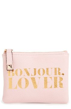 b461ed193 Showing off Parisian sophistication with this playful pink coin pouch  shaped from soft, pebbled leather
