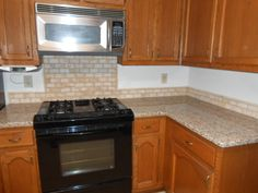 CREME CARAMEL Granite 60/40  sink Half Bull-nose edge 2x4 Light Travertine  Medium kitchen cabinets Visit us at http://www.fireplacecarolina.com  To See Our GRANITE COUNTERTOP PACKAGE DEAL