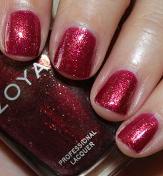 Teigen is a medium purple/red with copper shimmer.