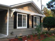 Pergola over windows. I like how the pergola creates a triangle with the roof