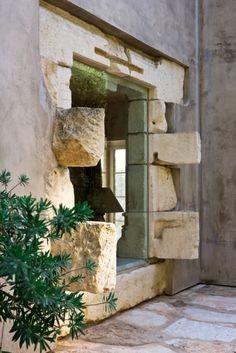 rustic stone w inset contempo window (grn glass)