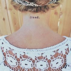 Freed.  Girls neck tattoo typewriter font small word Jesus tattoo God church Christian freedom ink free simple