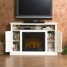 amazing-electric-fireplace-with-black-fireplace-and-burnt-wood-display-also-white-mantelshelf-and-dvd-player-featuring-flat-screen-television-and-laminate-flooring-plus-house-plant