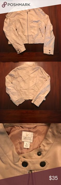 Faux leather Lauren Conrad cream jacket Cream faux leather jacket by Lauren Conrad. Near perfect condition! A little wrinkled in the pictures from being in storage during home renovations. Just needs to be hung out and will be in perfect condition. Two buttons at neck for a little edge. Two buttons on each sleeve at wrist as well. Zipper pockets on front. Size XL women's LC Lauren Conrad Jackets & Coats