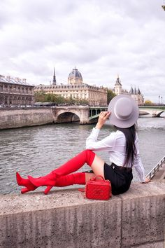 Red over the knee boots sit high on the list when it comes to the 'it' shoes of the season. Today, I'll be sharing my top styling tips for pairing them.