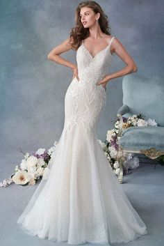 V-neck, beaded, mermaid gown with shimmer tulle available off-the-rack at Silk Bridal Studio.