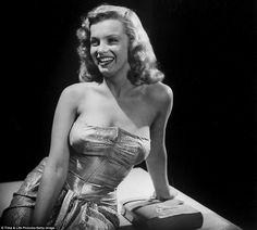 Studio portrait of Marilyn Monroe posing in a strapless evening gown, Hollywood, Calif., November 1948.